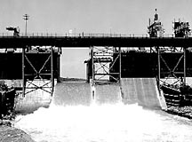 1962 - Water pours through the spillway at Cowans Ford Dam.